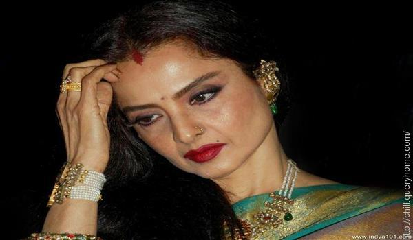 crimson or chocolate colored lipstick on rekha
