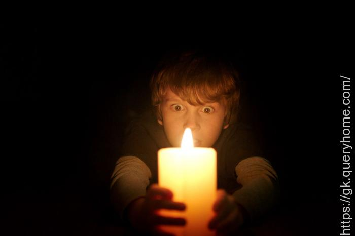 How far away can you see a candle in the dark
