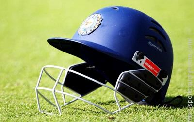 Who was the first Indian cricketer to wear a helmet during a match?