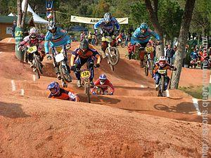 In cross-country bike racing, BMX represents the team Bicycle Moto X (cross).